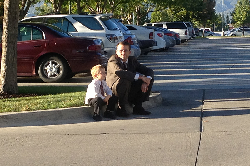 bryun-kevin-sitting-on-the-curb-at-the-temple-800-original